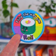 I Like the ay You Roll iron-on patch photo against room backdrop.